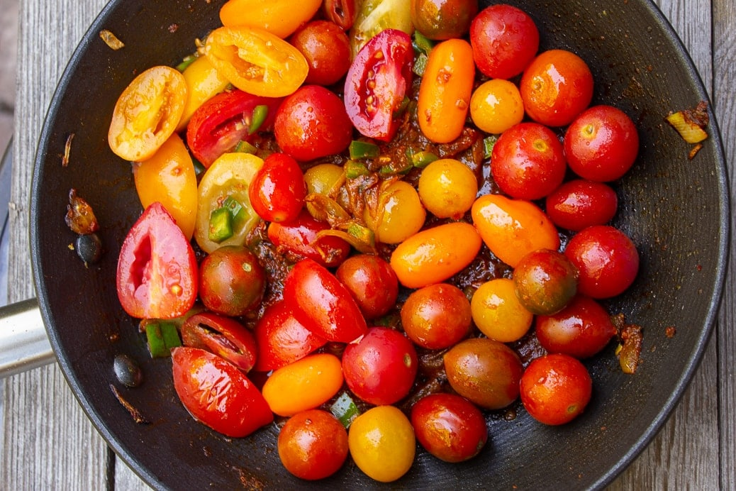 cherry tomatoes and sauce ingredients in pan