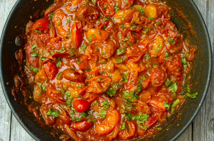 cherry tomato sauce in pan with cilantro 3