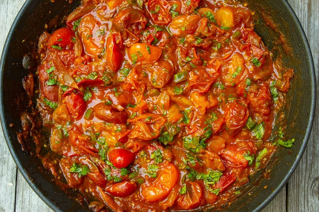 cherry tomato sauce in pan with cilantro 1