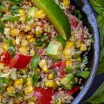Corn and tomato salad with quinoa in bowl p