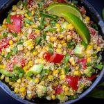 Corn and tomato salad with quinoa in bowl f