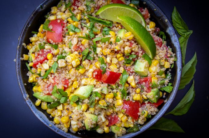 Corn and tomato salad with quinoa in bowl f