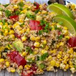 Corn and tomato salad with quinoa on glass plate p