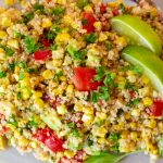 Corn and tomato salad with quinoa on glass plate p1