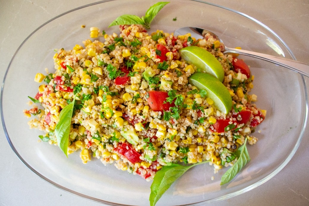 Corn and tomato salad with quinoa on glass plate