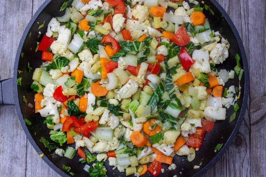 veggies frying in pan