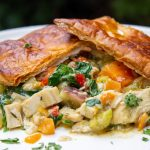 chicken pot pie filling on plate with crust on top ff