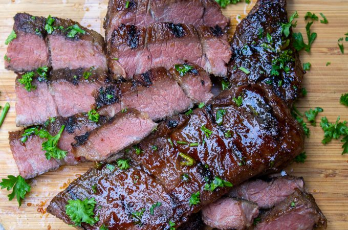 sliced grilled sous vide short ribs on cutting board