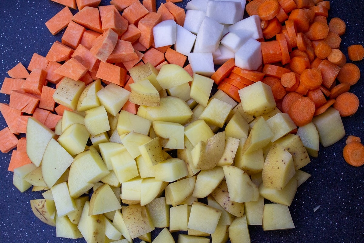 cubed root vegetables on cutting board