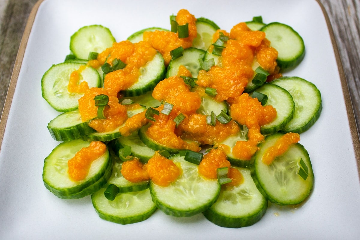 Japanese salad dressing drizzled on Japanese cucumbers on plate ff