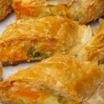 cut up knishes filled with root vegetable mash on serving platter p