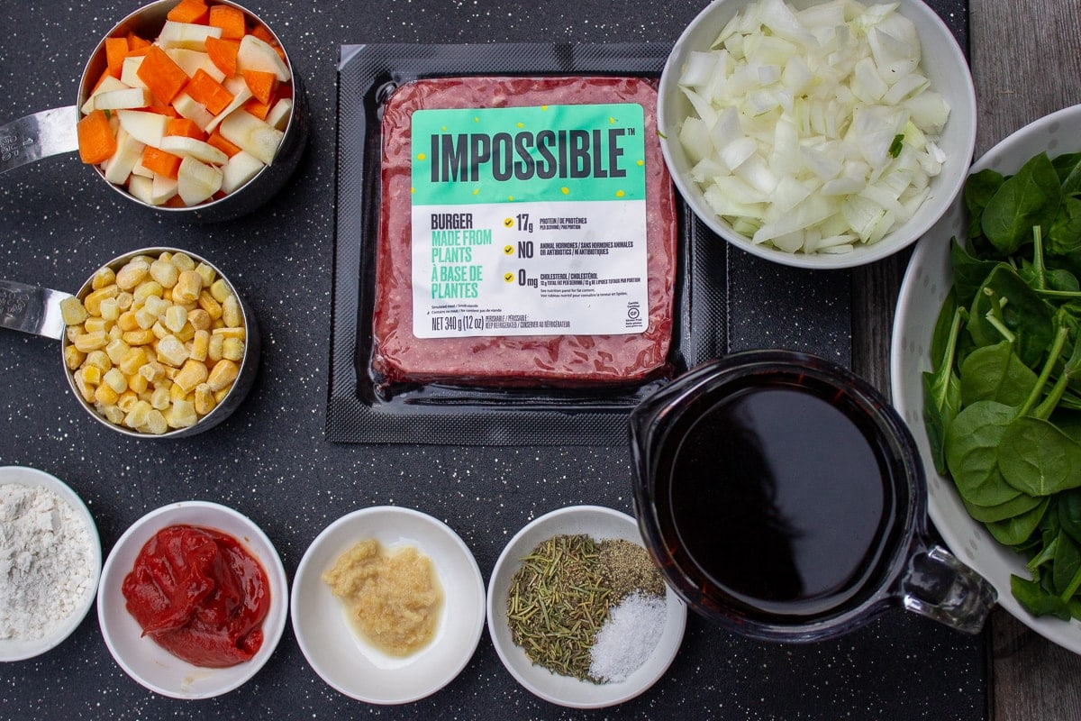 Impossible Burger (plant-based beef), chopped onions, small diced veggies, frozen corn, seasonings, flour, broth and wine, baby spinach.