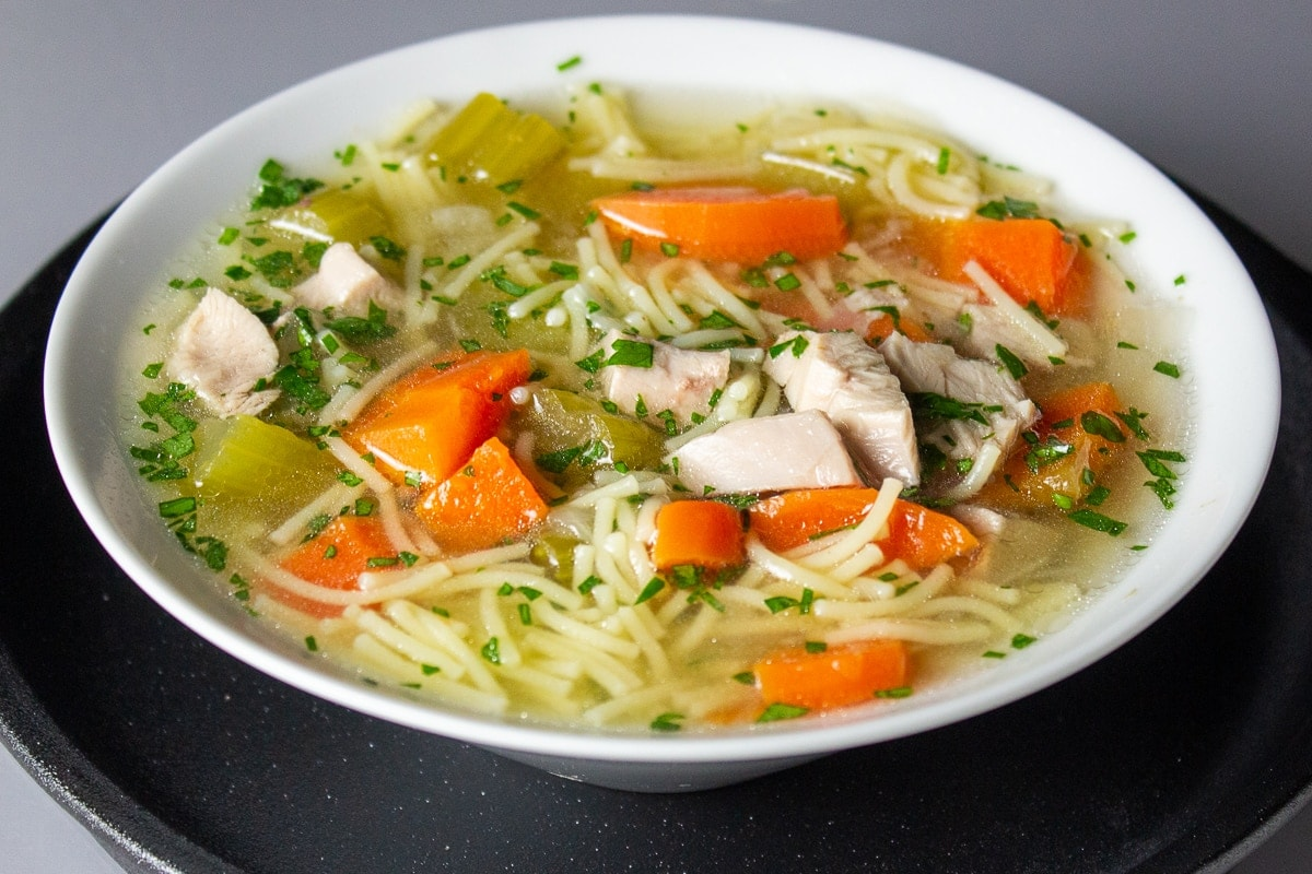 bowl of turkey soup with noodles