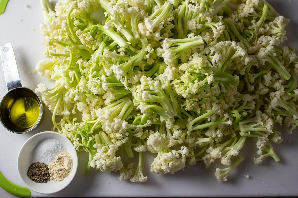 Recipe ingredients: cut up baby cauliflower, olive oil, salt, pepper and optional garlic powder.