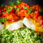 baked cod fillets covered with cherry tomato sauce over cauliflower spinach rice p