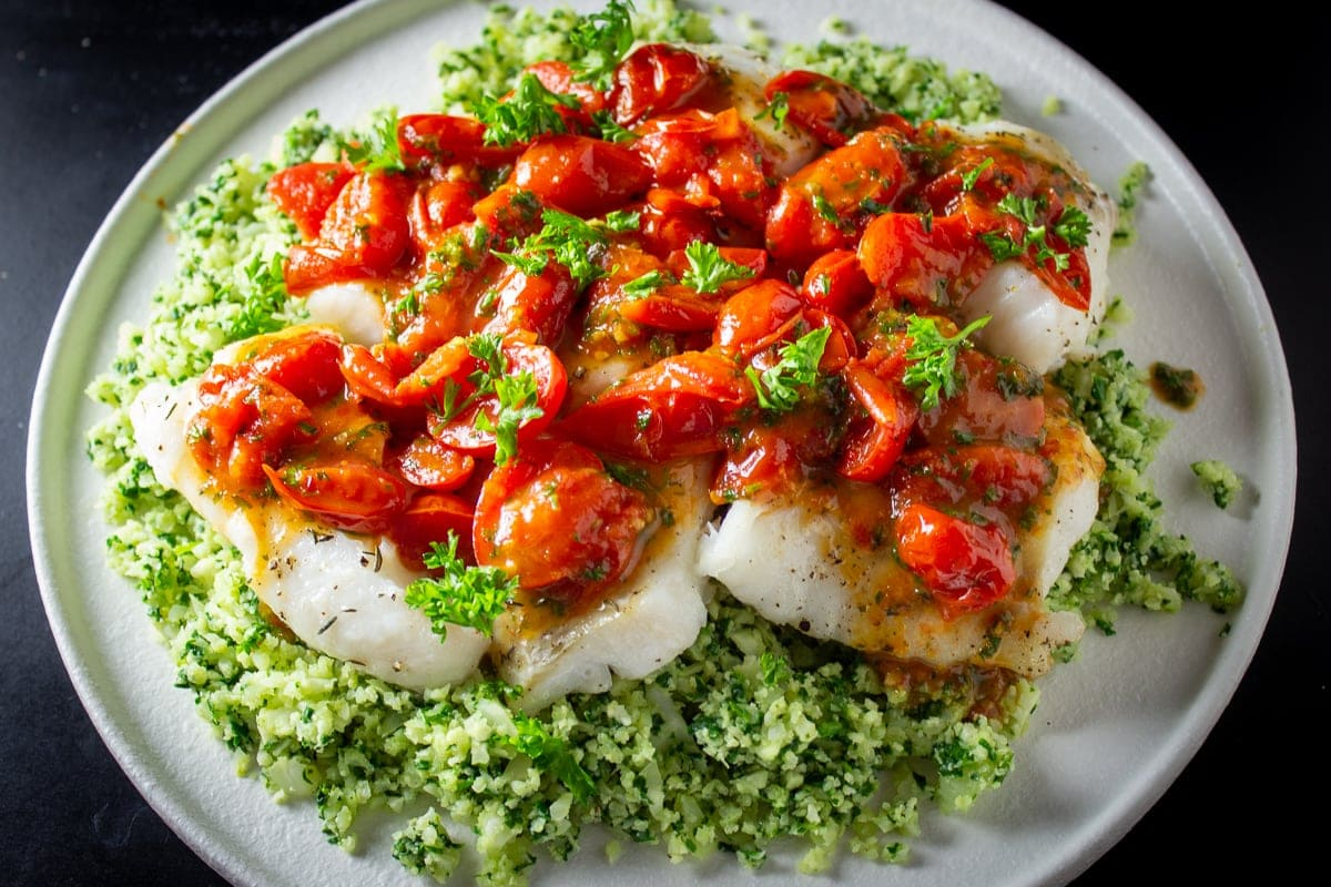 baked cod fillets covered with cherry tomato sauce over cauliflower spinach rice 2