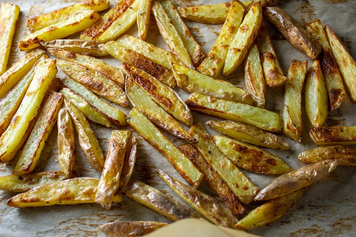baked fries laying on pan