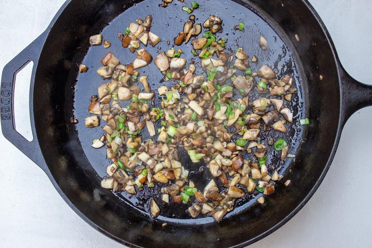 mushrooms, garlic, onions sauteed in pan