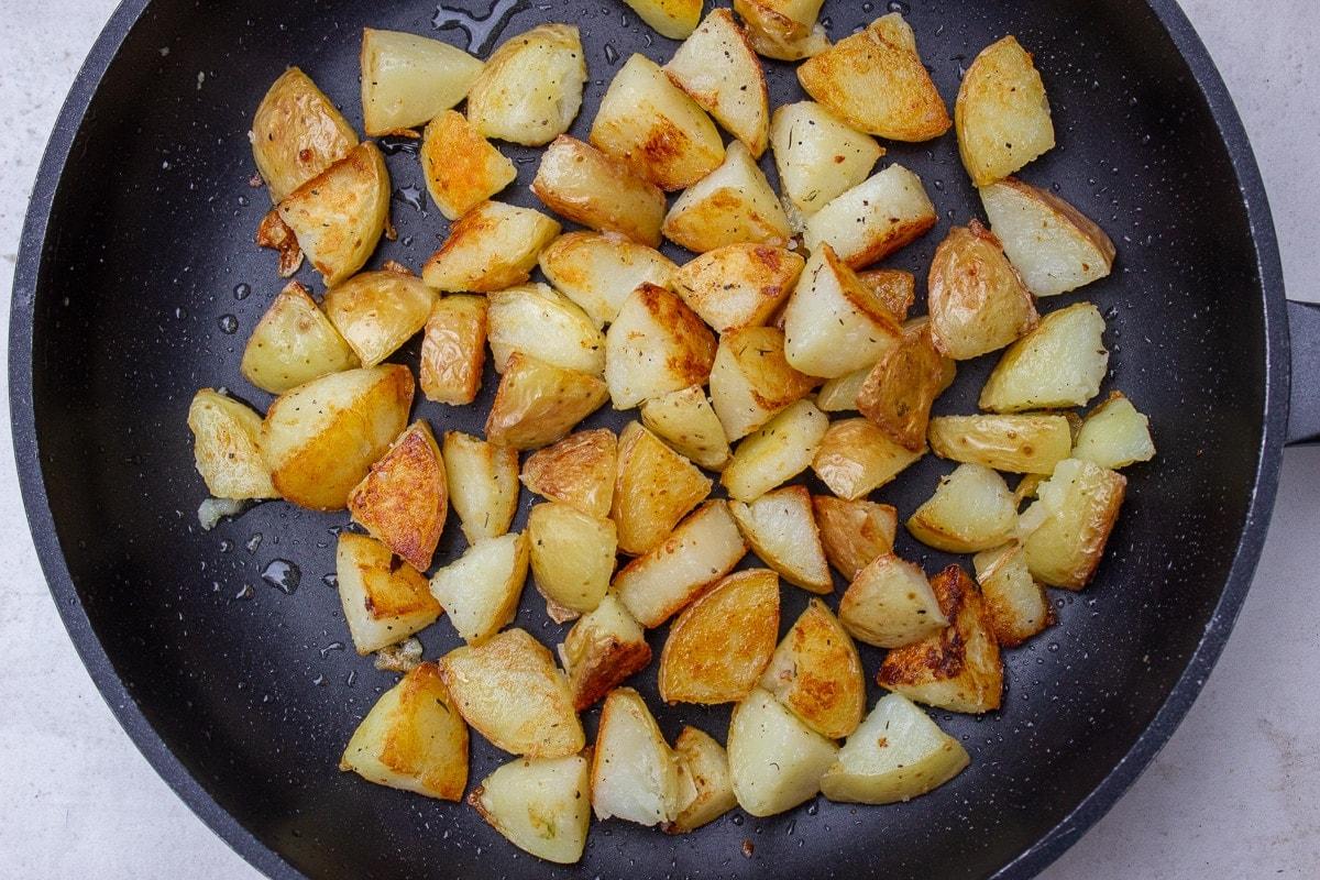 fried potatoes in skillet