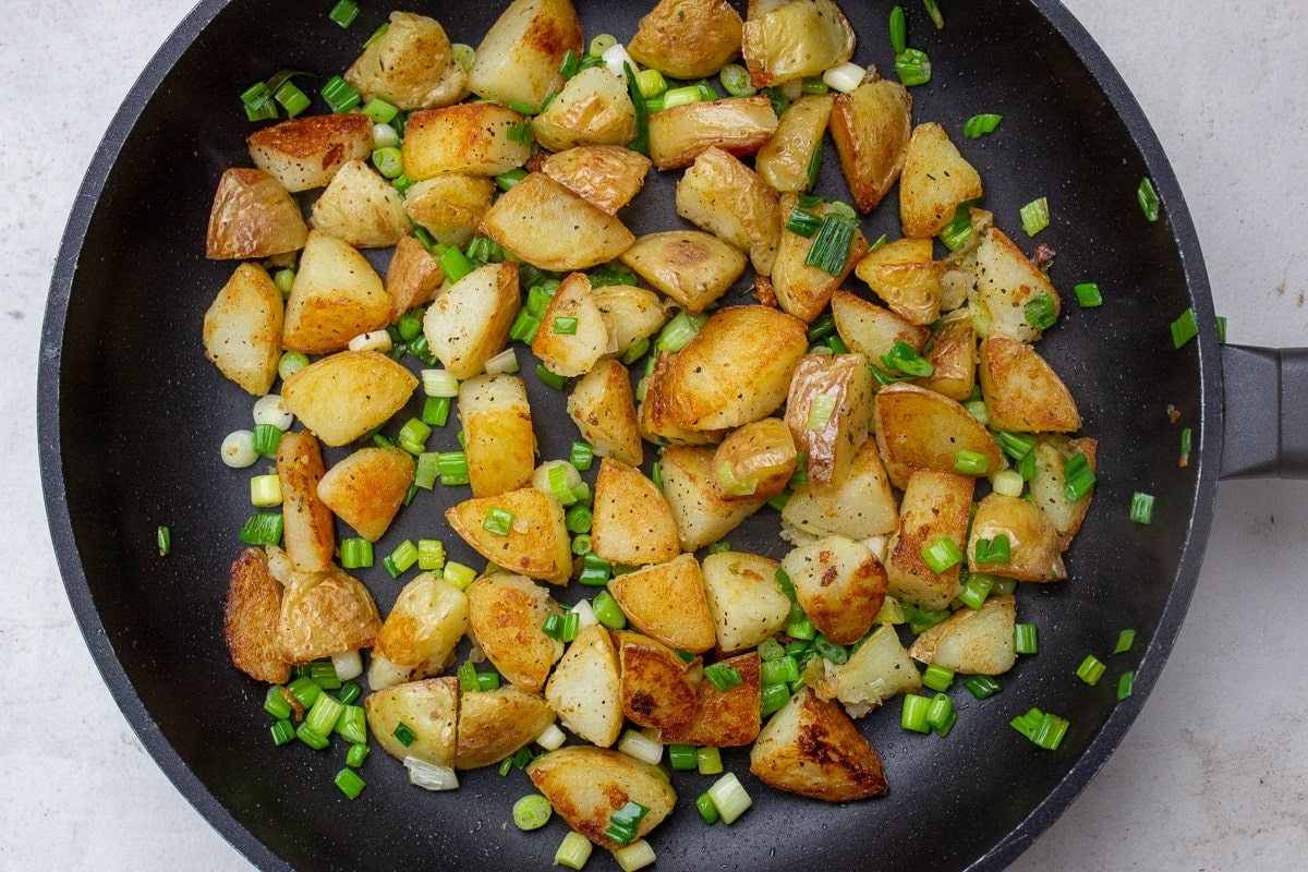fried potatoes and onions in skillet