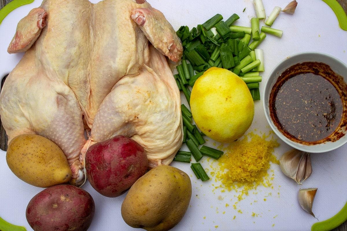 butterflied chicken, potatoes, lemon and zest, onions, seasoning
