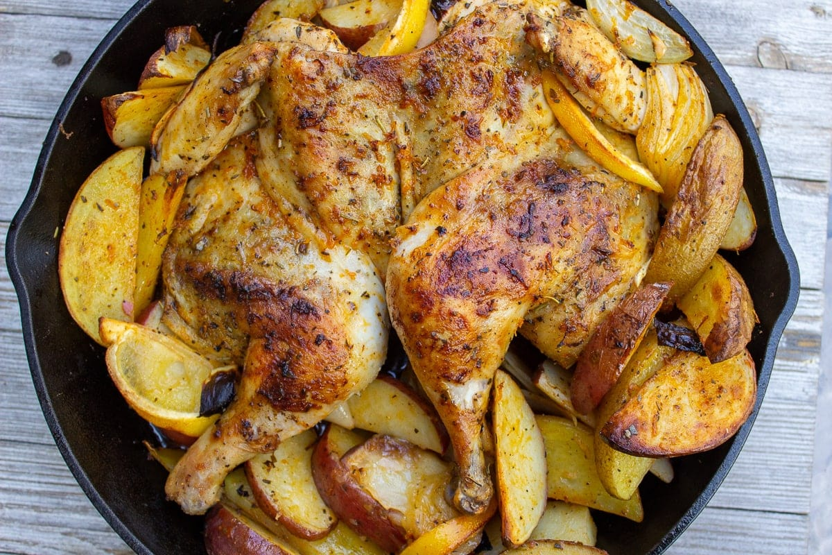 roasted chicken and potatoes in skillet