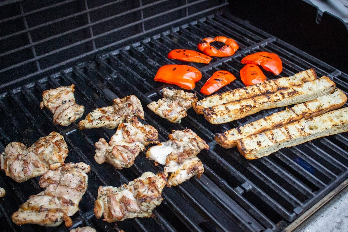 chicken, bread, peppers on grill