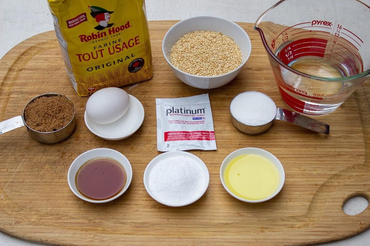 flour, sesame seeds, water, sugar, salt, yeast, egg, maple syrup, water, brown sugar