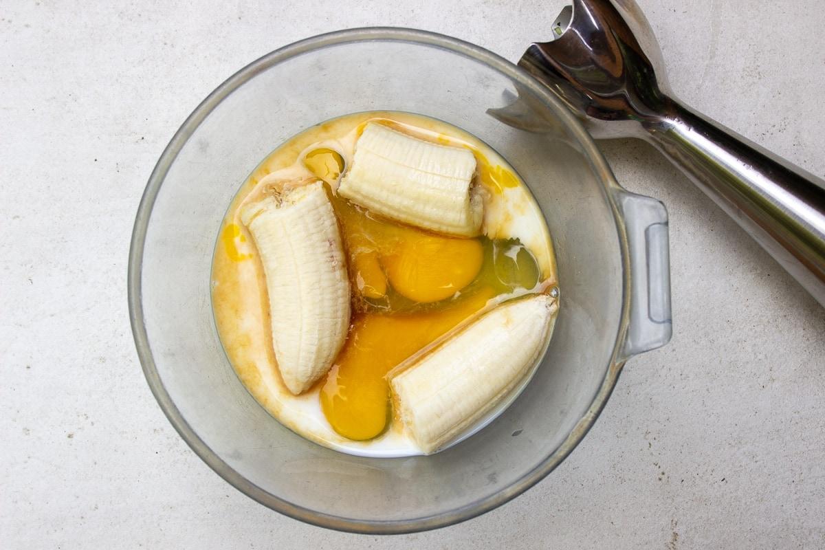 bowl with eggs, banana, milk, vanilla