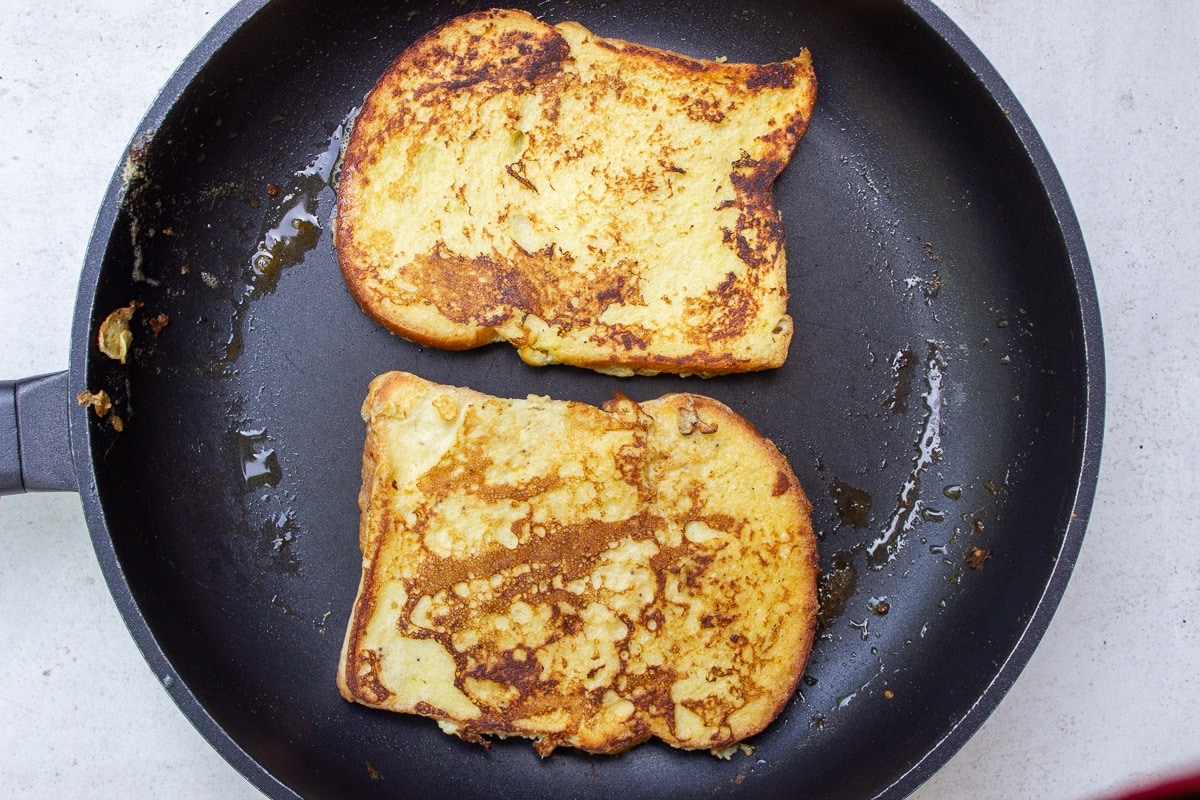 2 pieces browned French toast in pan