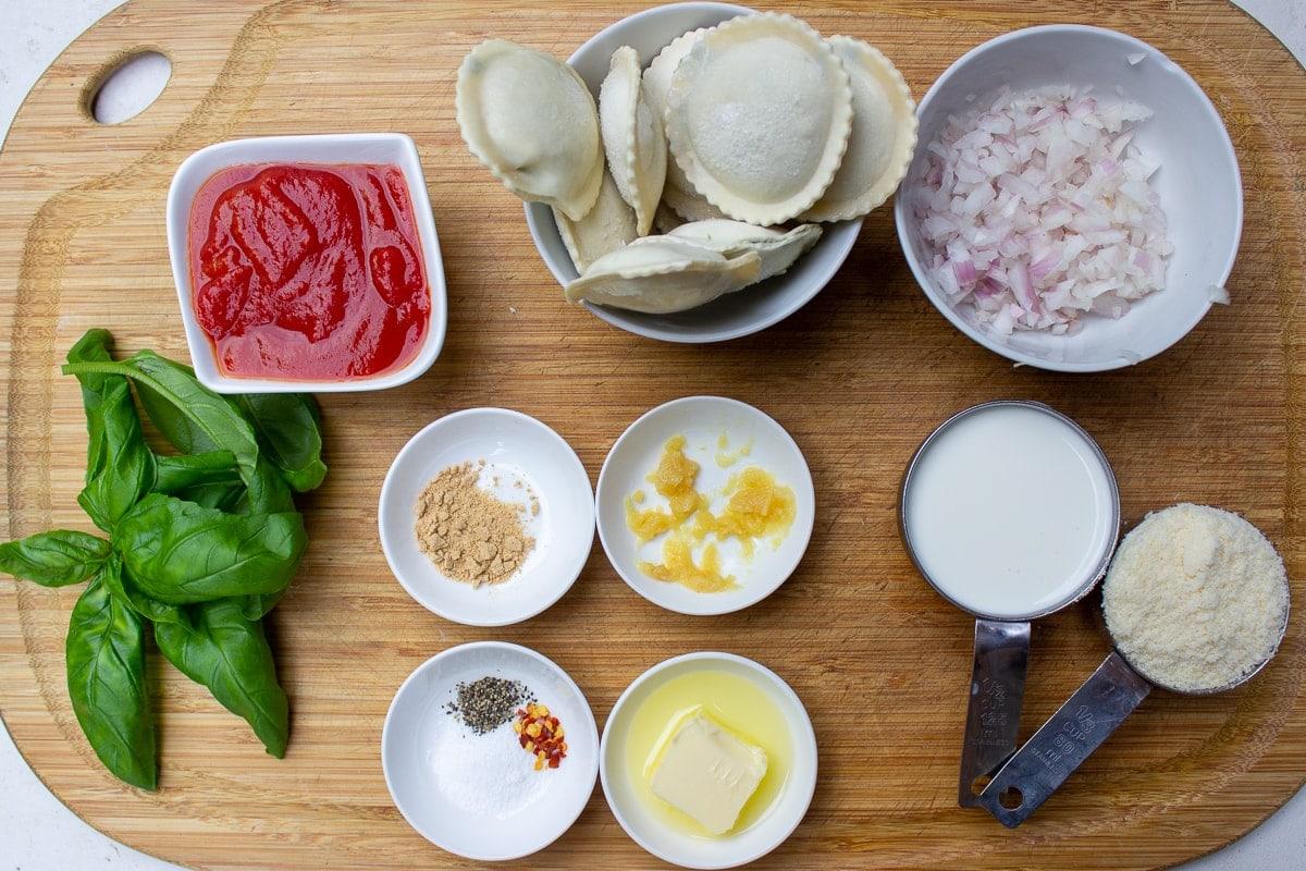 ravioli, onion, tomato sauce, basil, butter, seasonings, garlic, bouillon, cream, parmesan