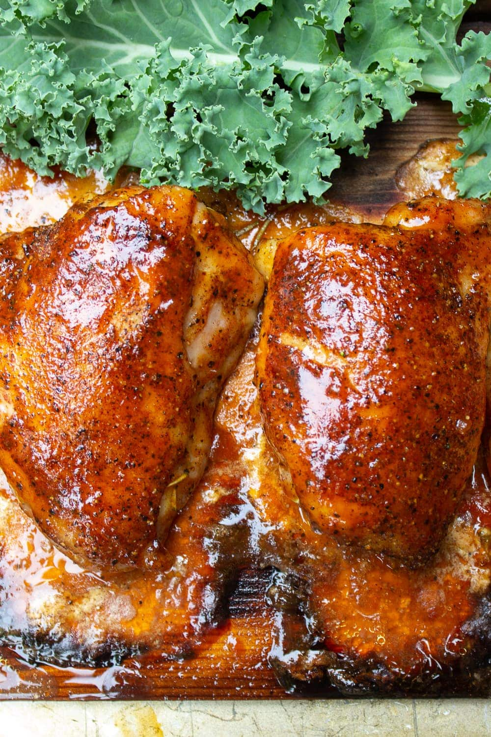 cooked chicken thighs on plank resting p