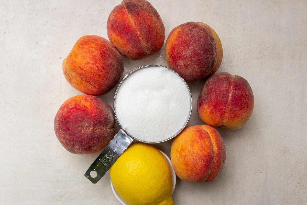 6 whole peaches, sugar, lemon