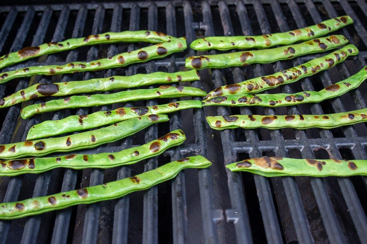green beans charring on grill