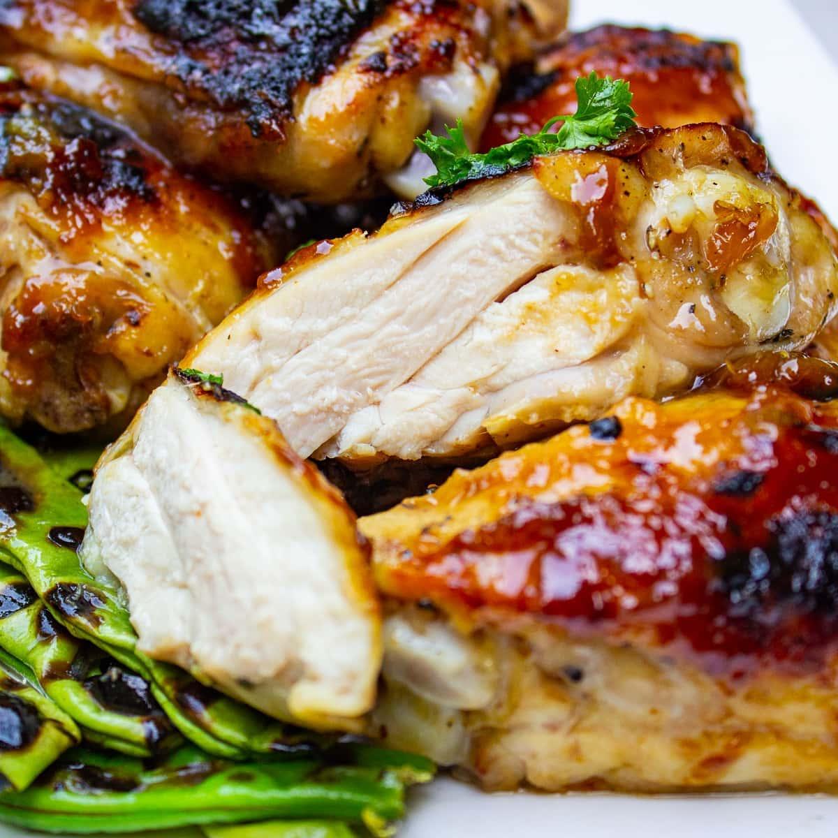 cut open juicy piece of chicken on plate