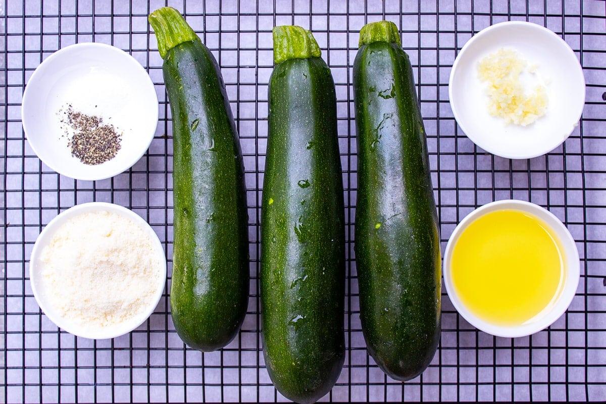 zucchinis, olive oil, garlic, parmesan, salt, pepper