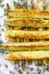 roasted zucchini spears on plate with microgreens-p