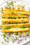 roasted zucchini spears on plate with microgreens-p2
