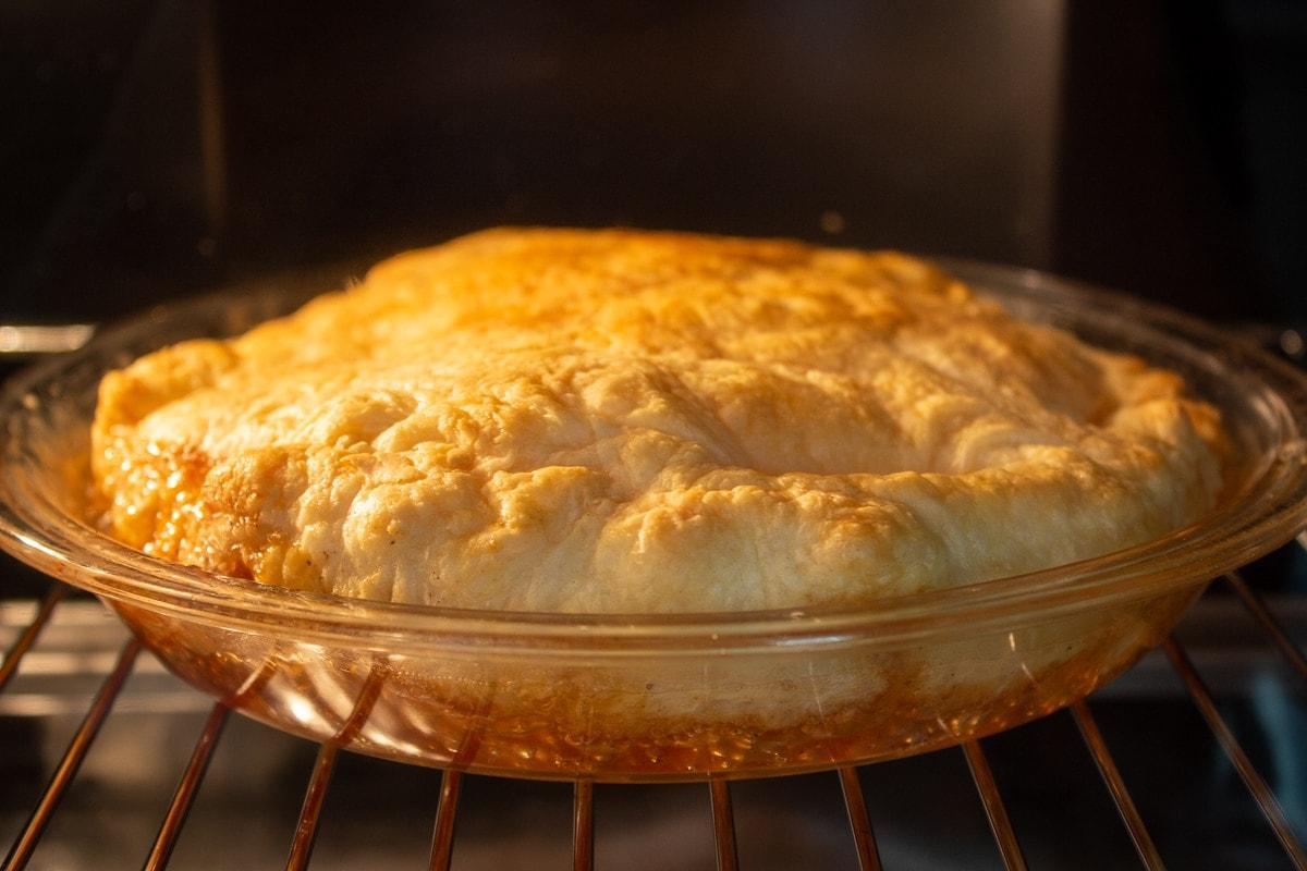 peach tarte titin in oven baking