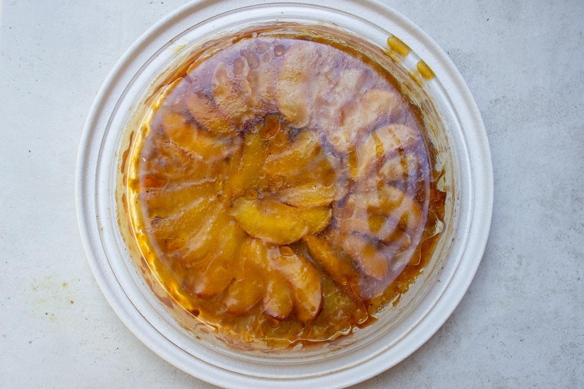 finished peach tart flipped onto plate