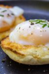poached eggs on english muffin on plate p
