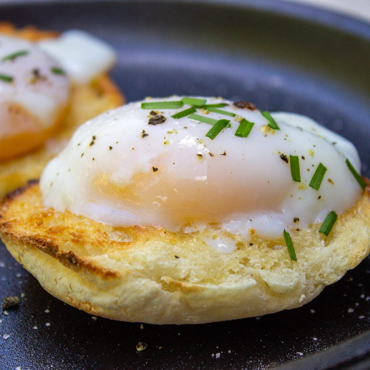 poached eggs on english muffin on plate