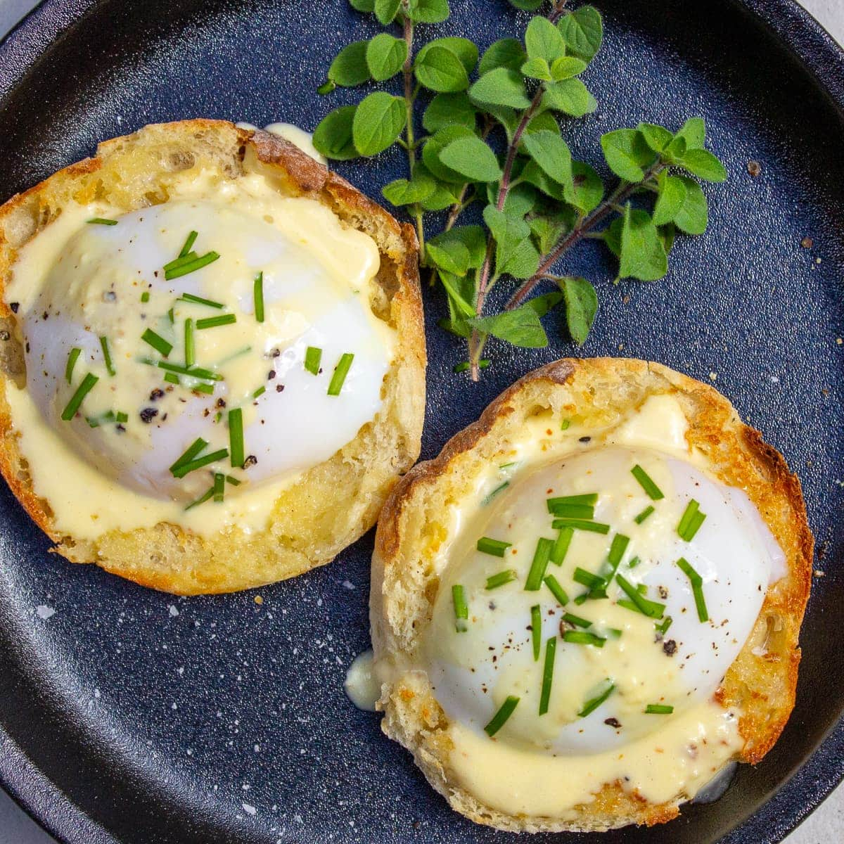sous vide poached eggs with hollandaise on plate