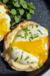 sous vide poached egg cut open over English muffin p1
