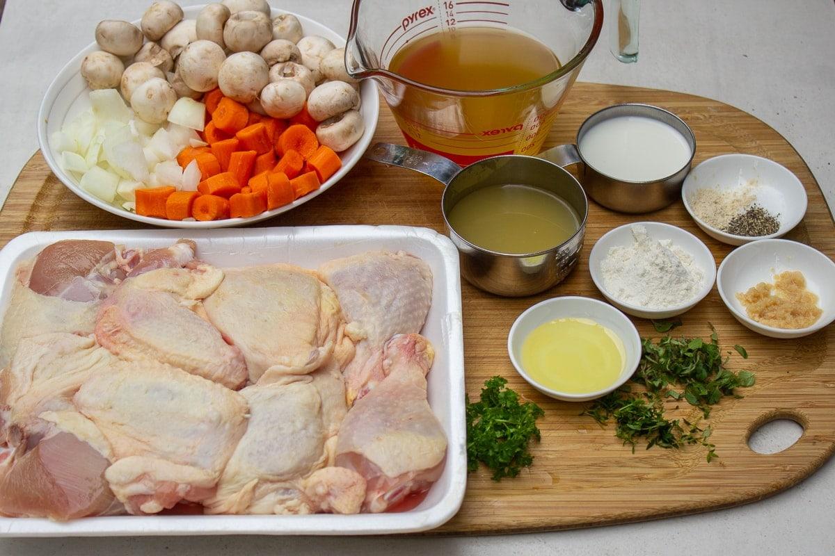 chicken pieces, mushrooms, onions, carrots, broth, wine, cream, herbs, garlic, oil, seasonings