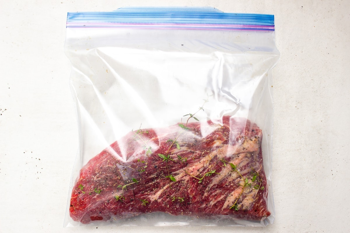 raw tri tip steak in ziploc bag