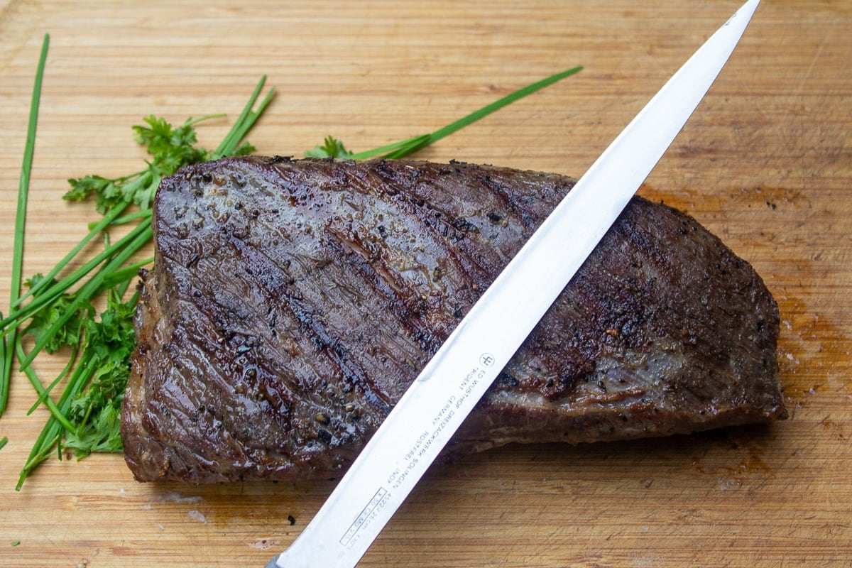 grilled tri tip on cutting board with knife