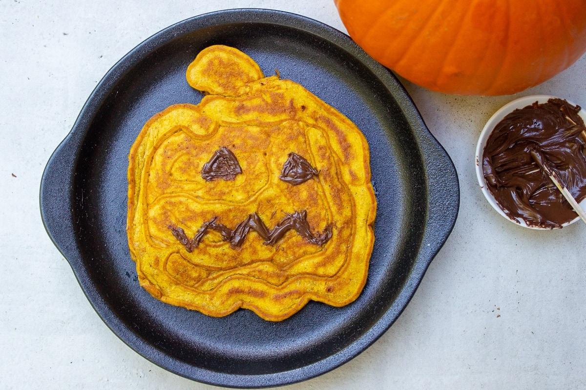pumpkin face pancake on plate