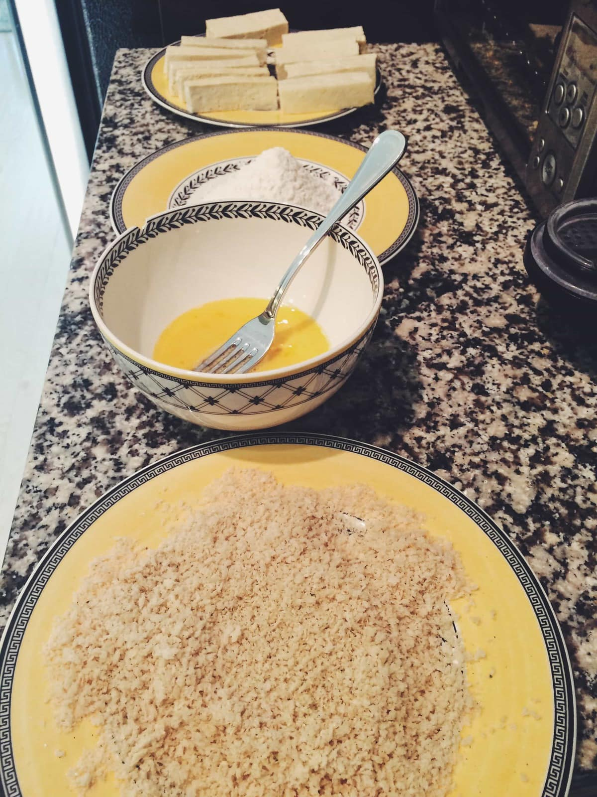 egg, panko crumbs, flour, tofu in assembly line